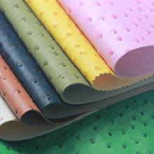 义乌厂家直销耐磨半PU鸵鸟纹人造革 箱包沙发服装装饰皮料