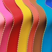 义乌厂家直销新款彩边PVC水波纹人造革 箱包时装包皮革面料