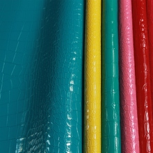 义乌厂家直销新款高光半PU石头纹人造革 箱包女包时装包皮革