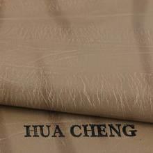 经典特色压变pu革 树皮纹 专用于商标 皮带革 厚度0.7mm 机织TC布