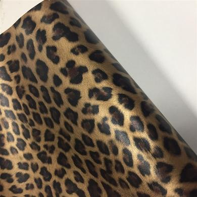 100纹贴膜豹纹.TC布底0.7mm厚,做眼镜盒用